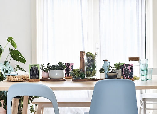 ikea-use-chopping-boards-to-display-plants-on-a-table__1364517878840-s31